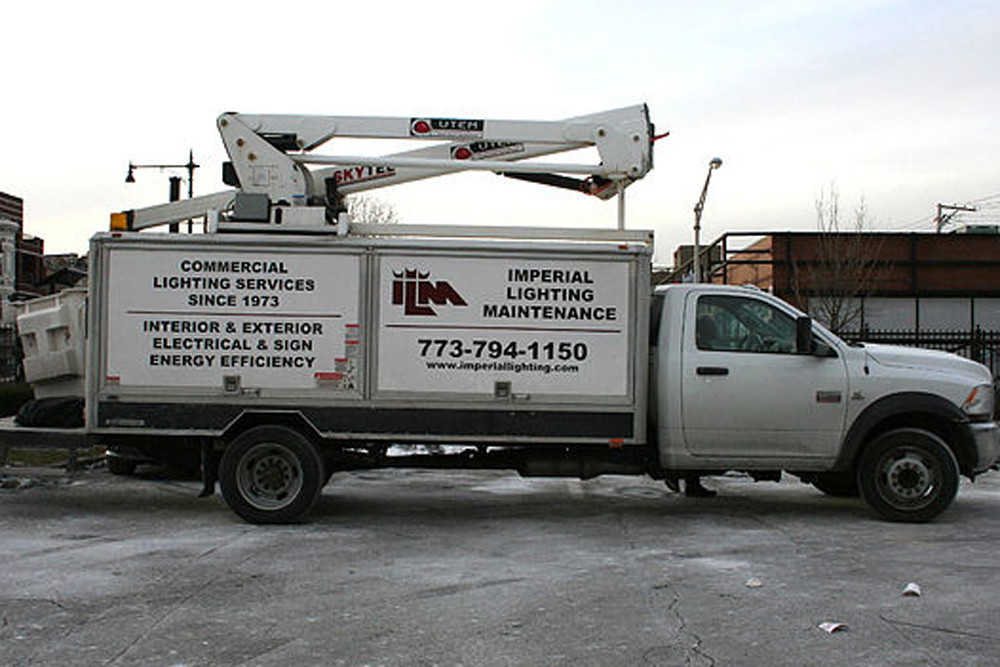 A service truck used to perform commercial exterior lighting upgrades and maintenance.