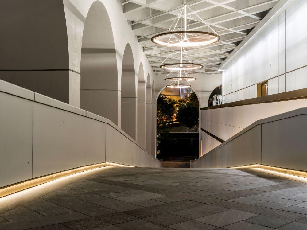 Corridor with modern LED light fixtures illuminated due to routine LED lighting maintenance.